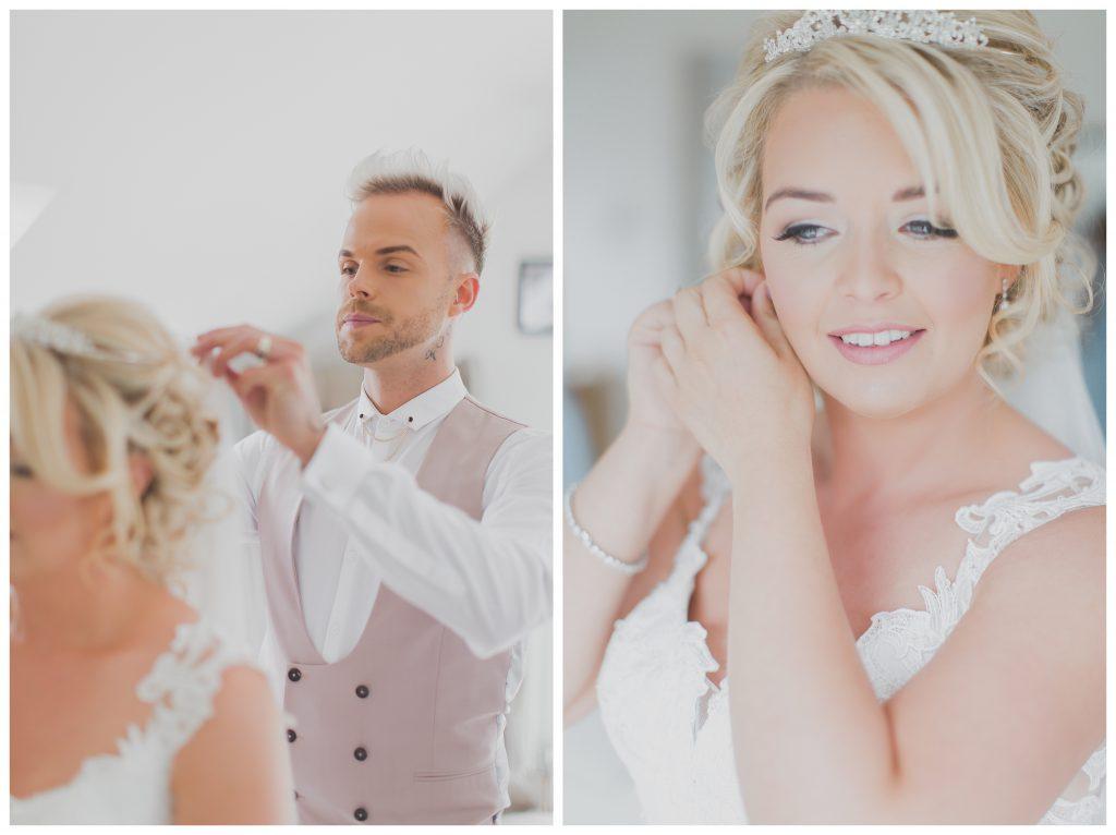 Bride putting earingings on