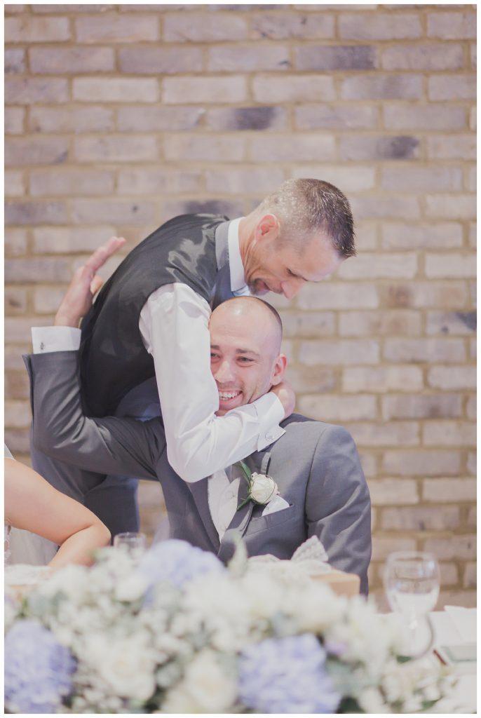 Bestman and groom hugging