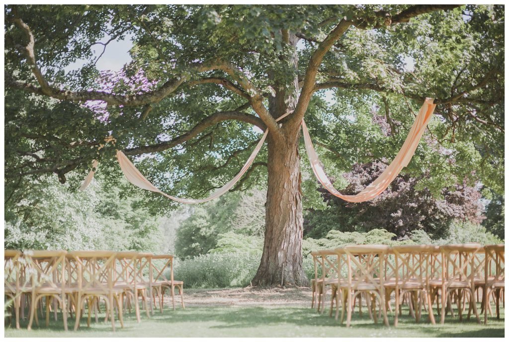 Ceremony under the oak tree of Courteenhall