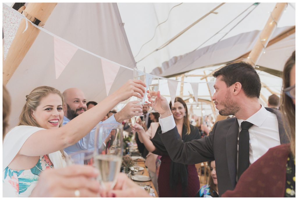 Guests raising their glasses to toast