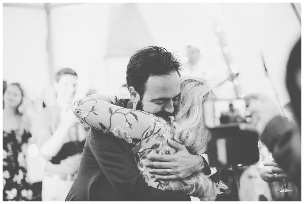 Groom hugging bride on the dance floor