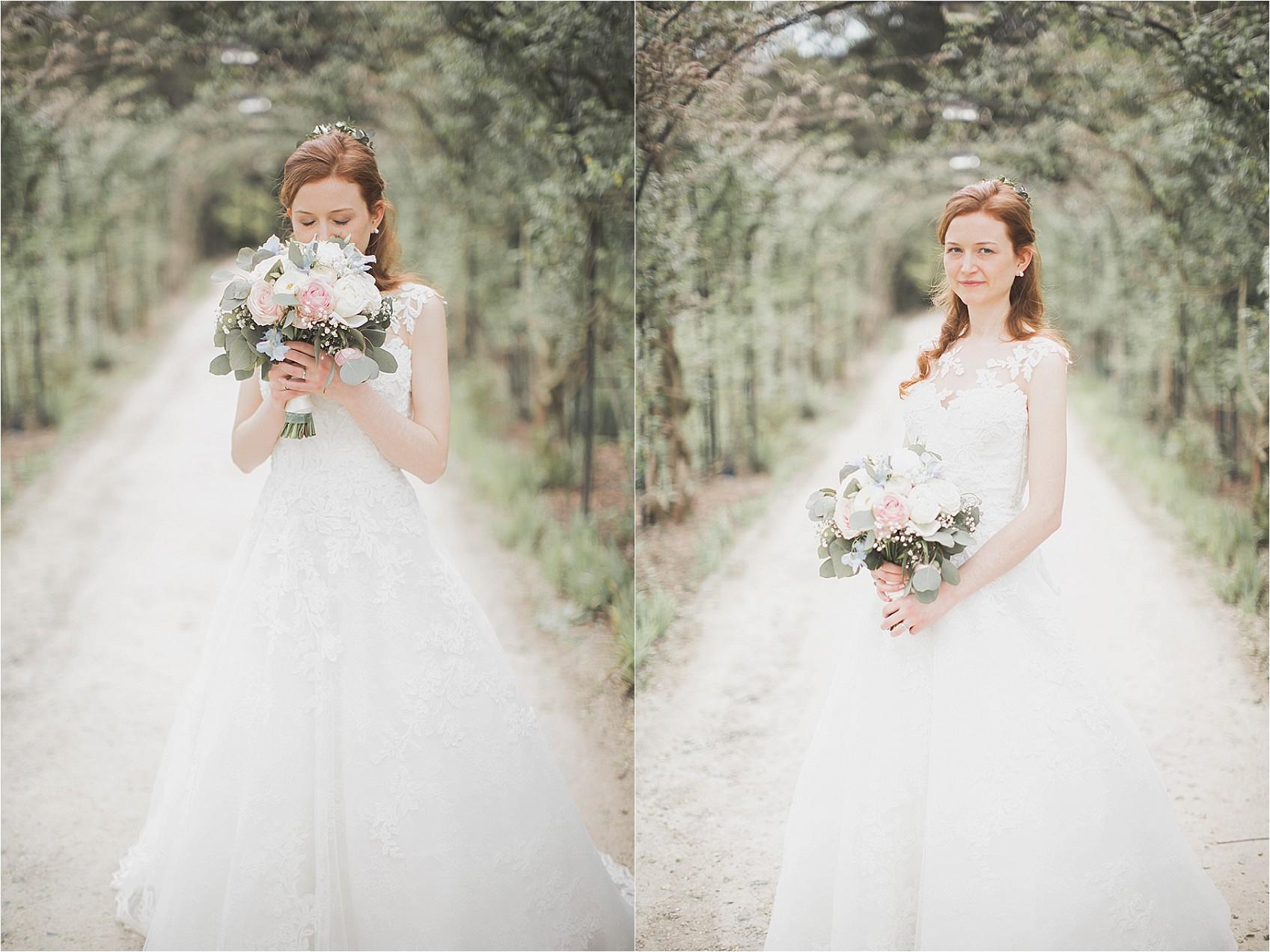 Bride smelling her wedding bouquet