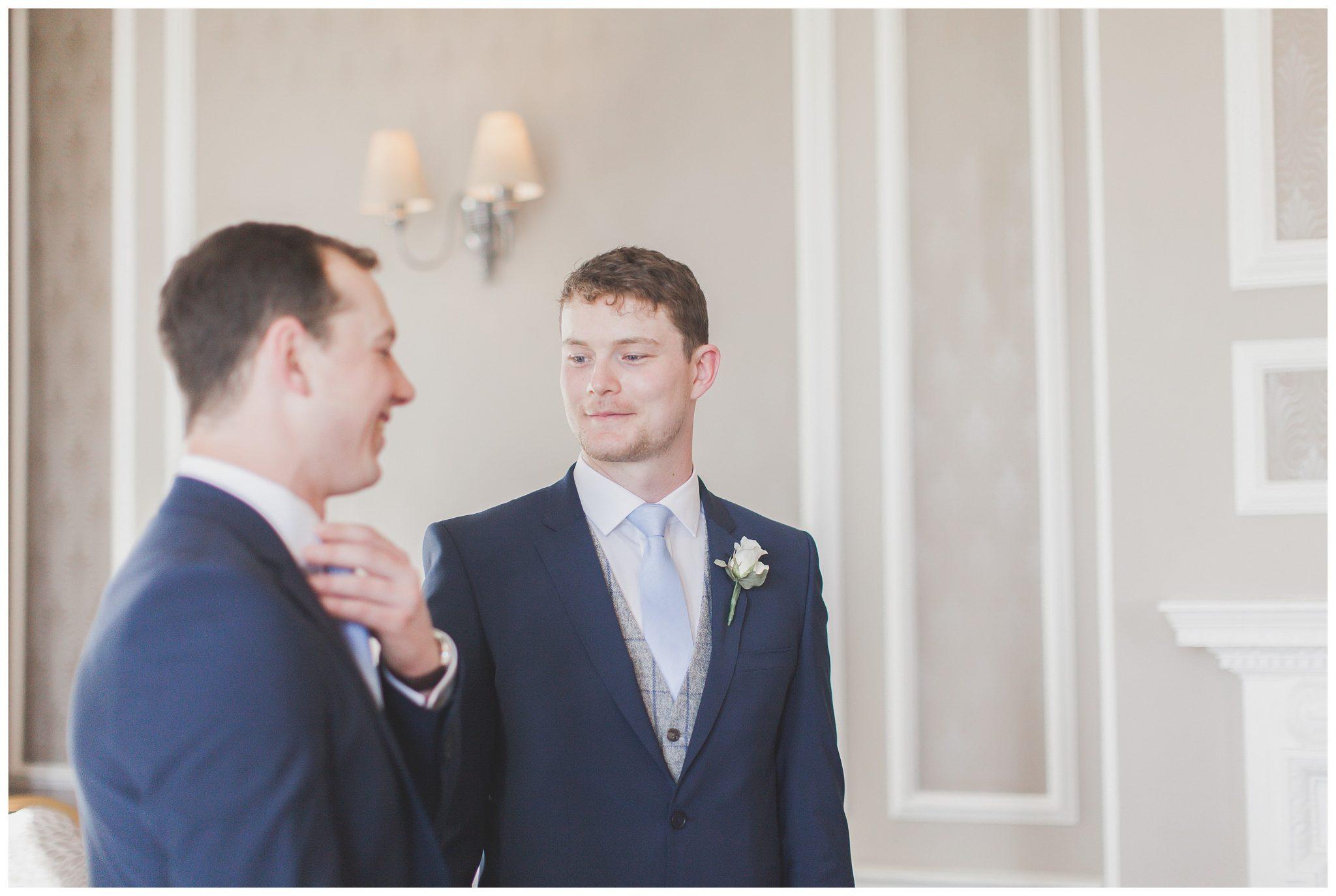 Best man looking at the groom
