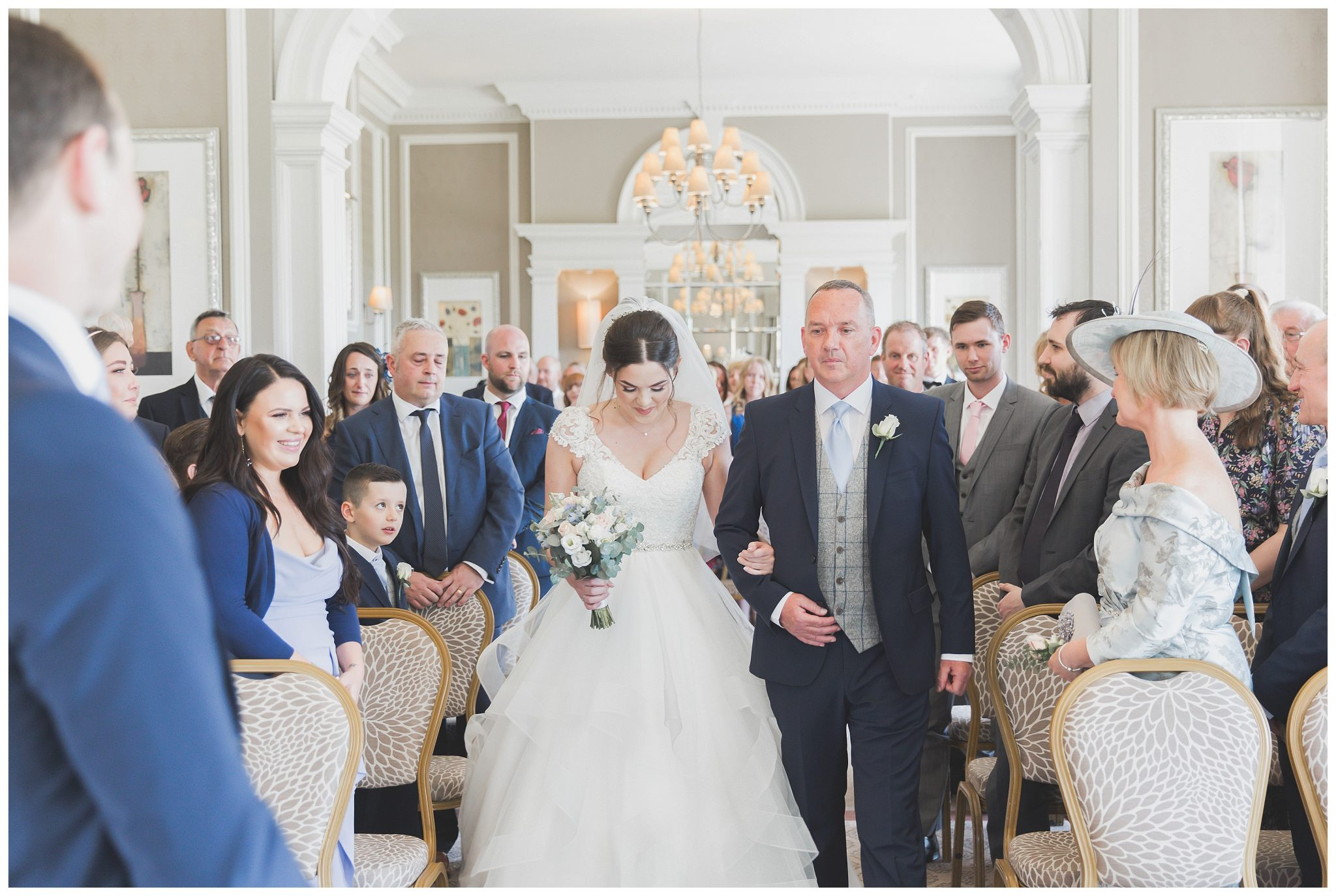 Bride walking up the isle with her dad
