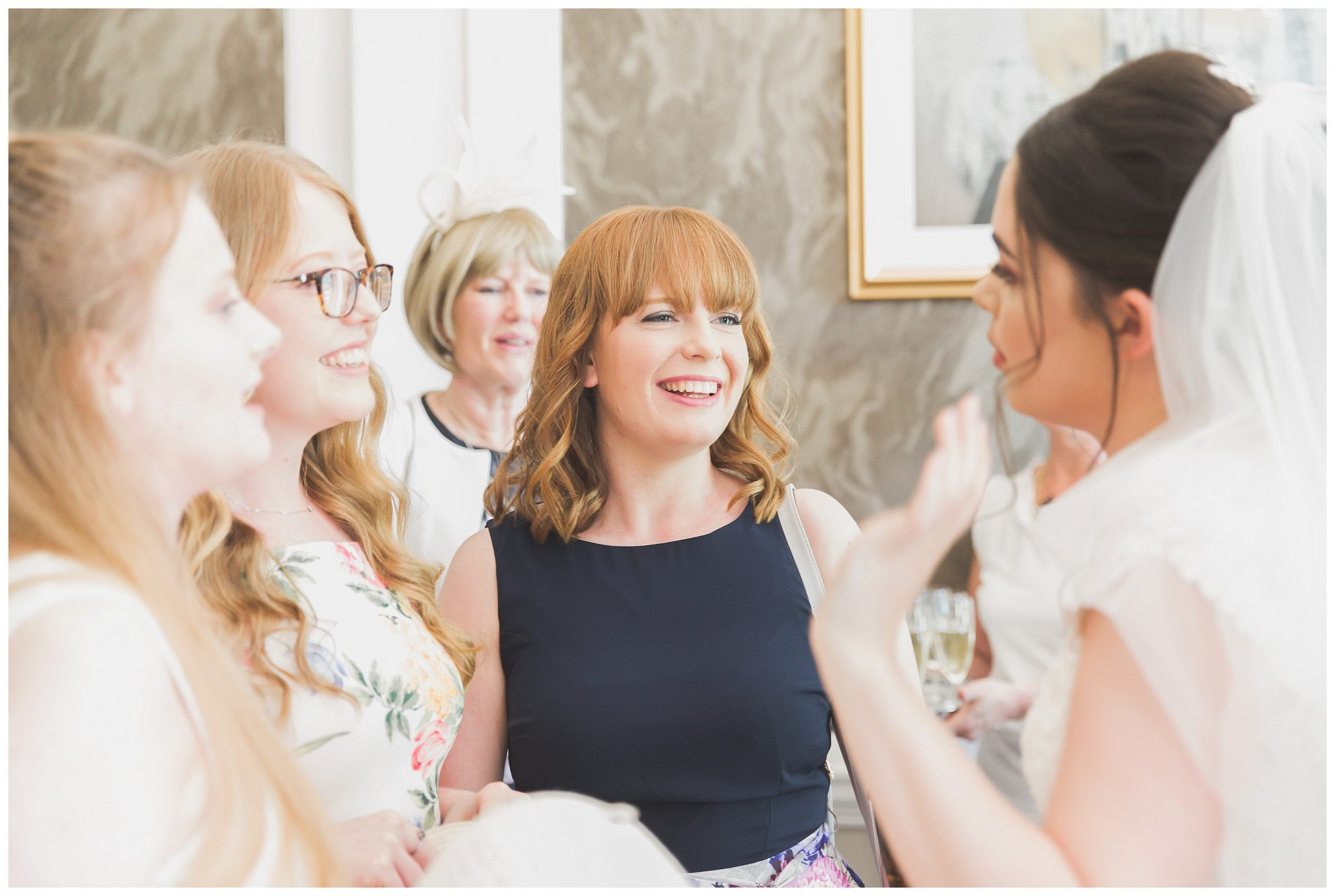 Bride talking to her friends