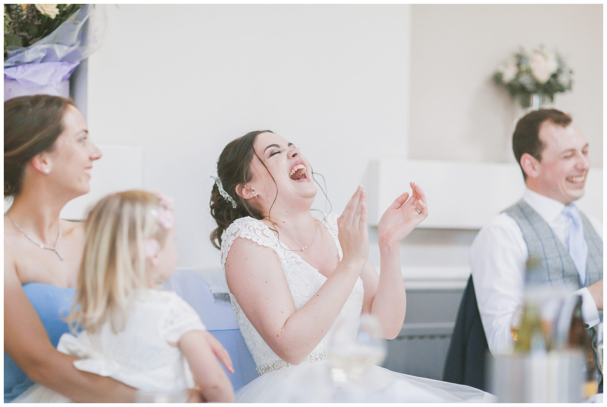 Bride laughing and clapping her hands