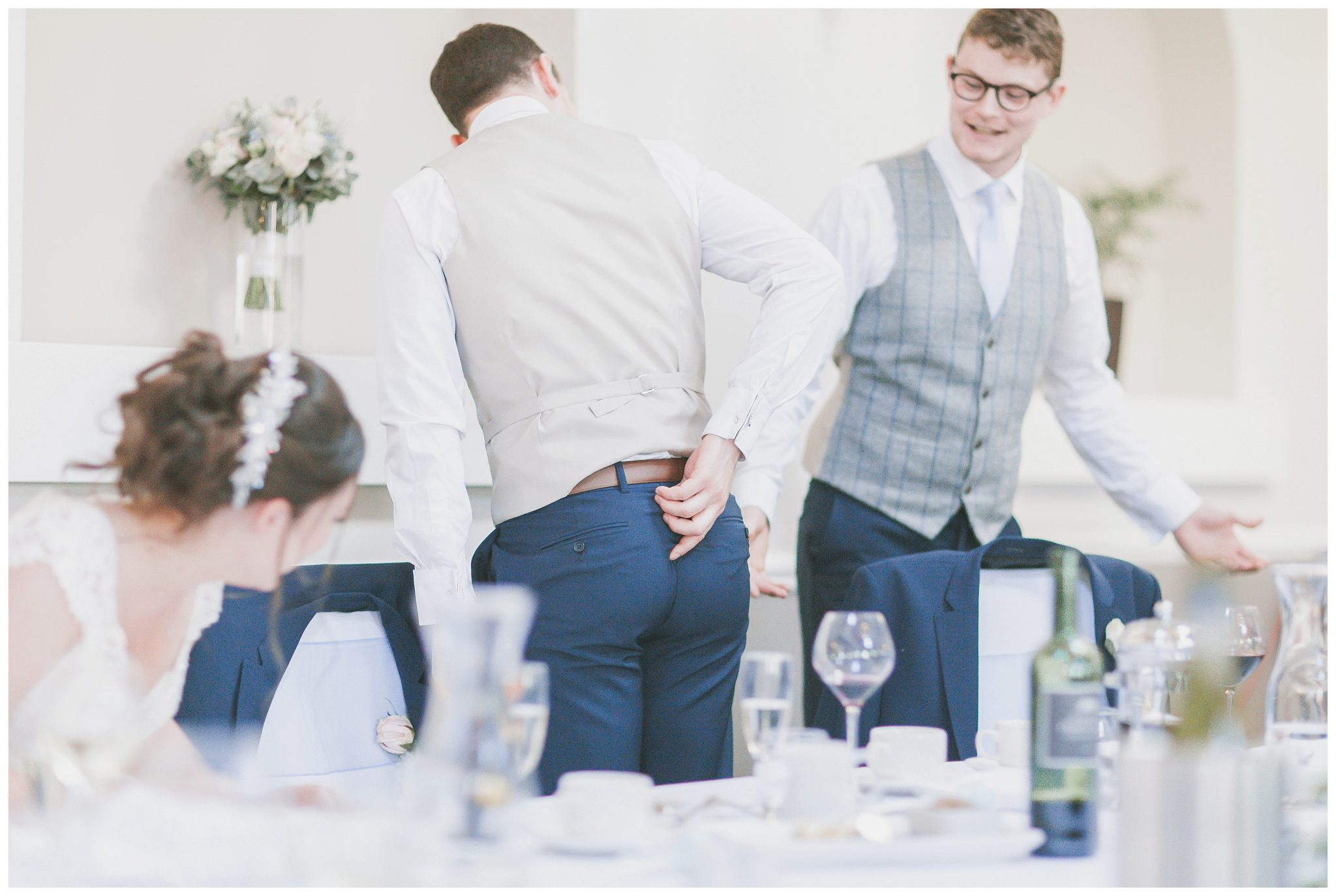 Groom showing everyone the split on his trousers