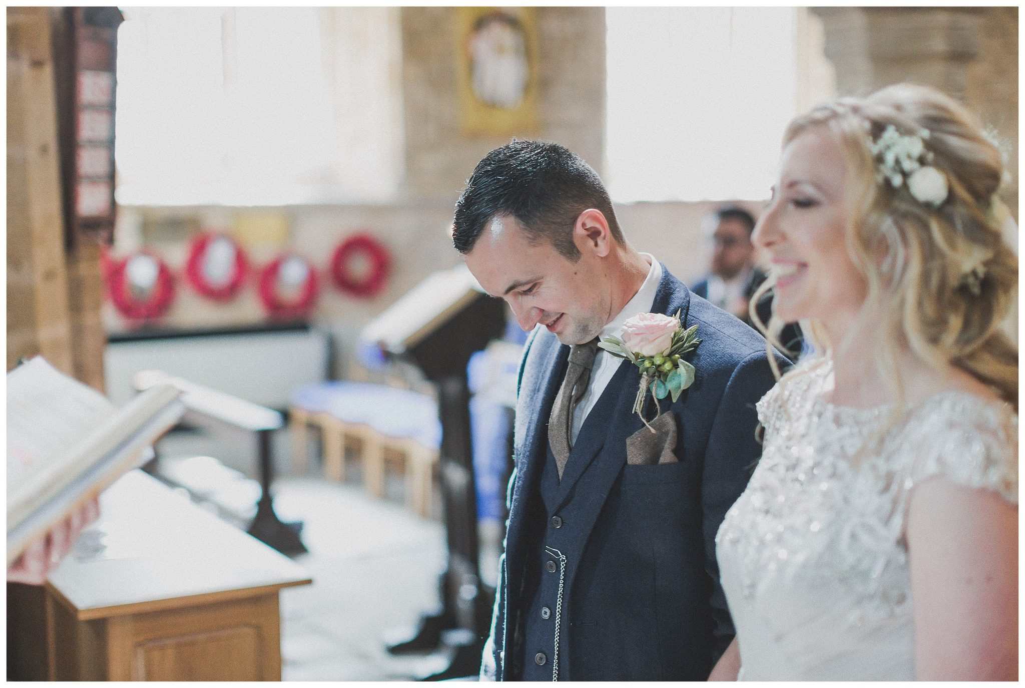 Daniel smiling in the curch with Hayley beside him