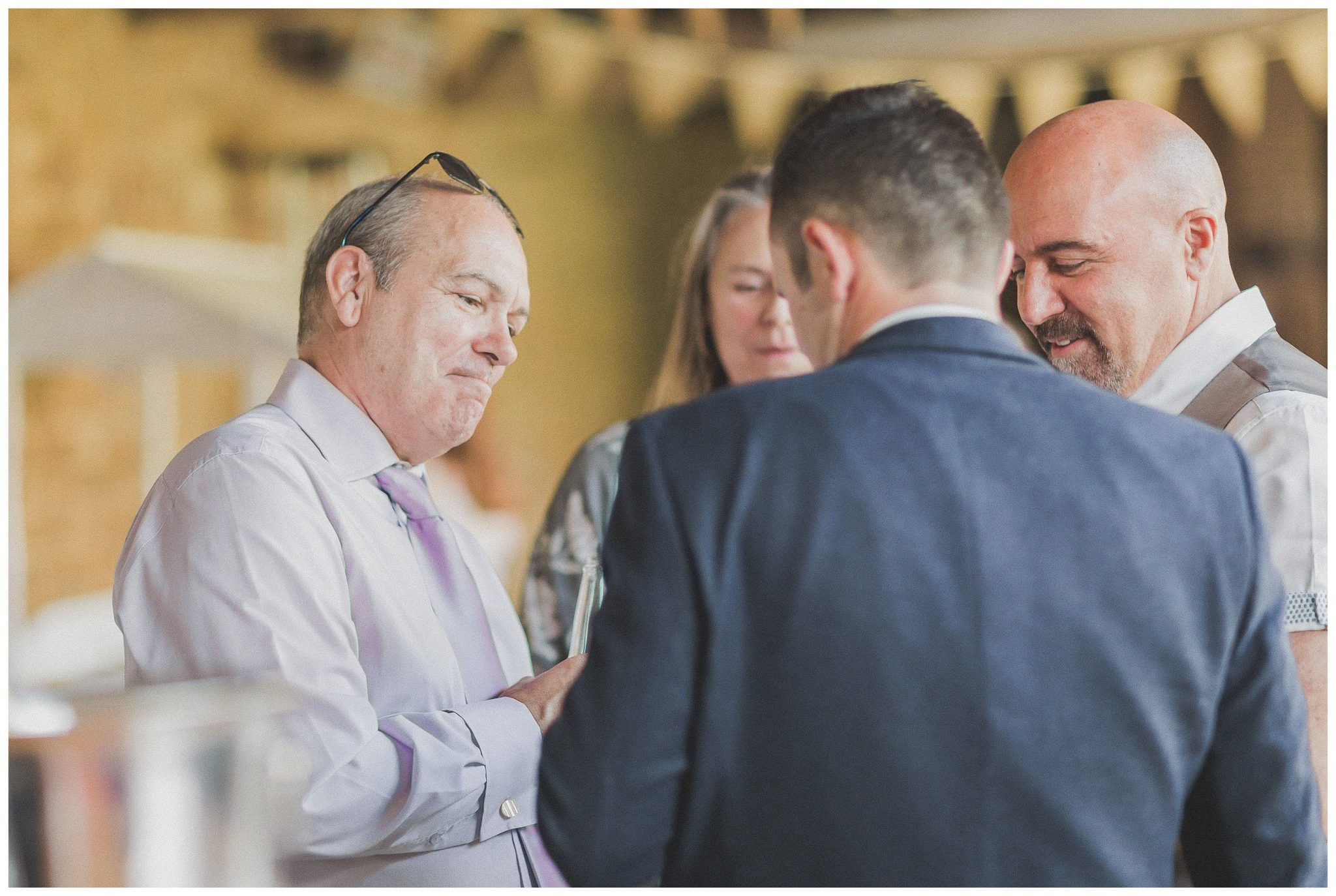 wedding guest smiling at groom