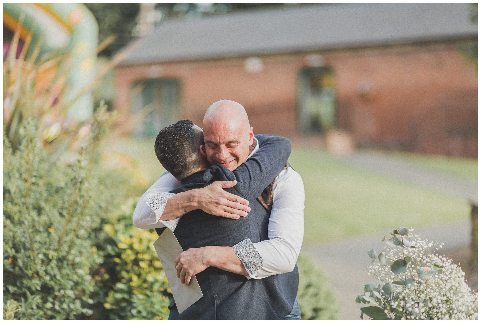 One of the guests hugging the groom