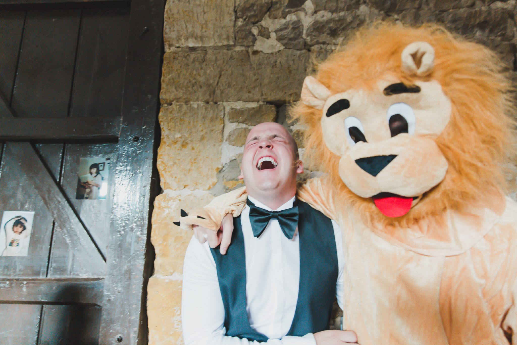 Groom laughing very loudly