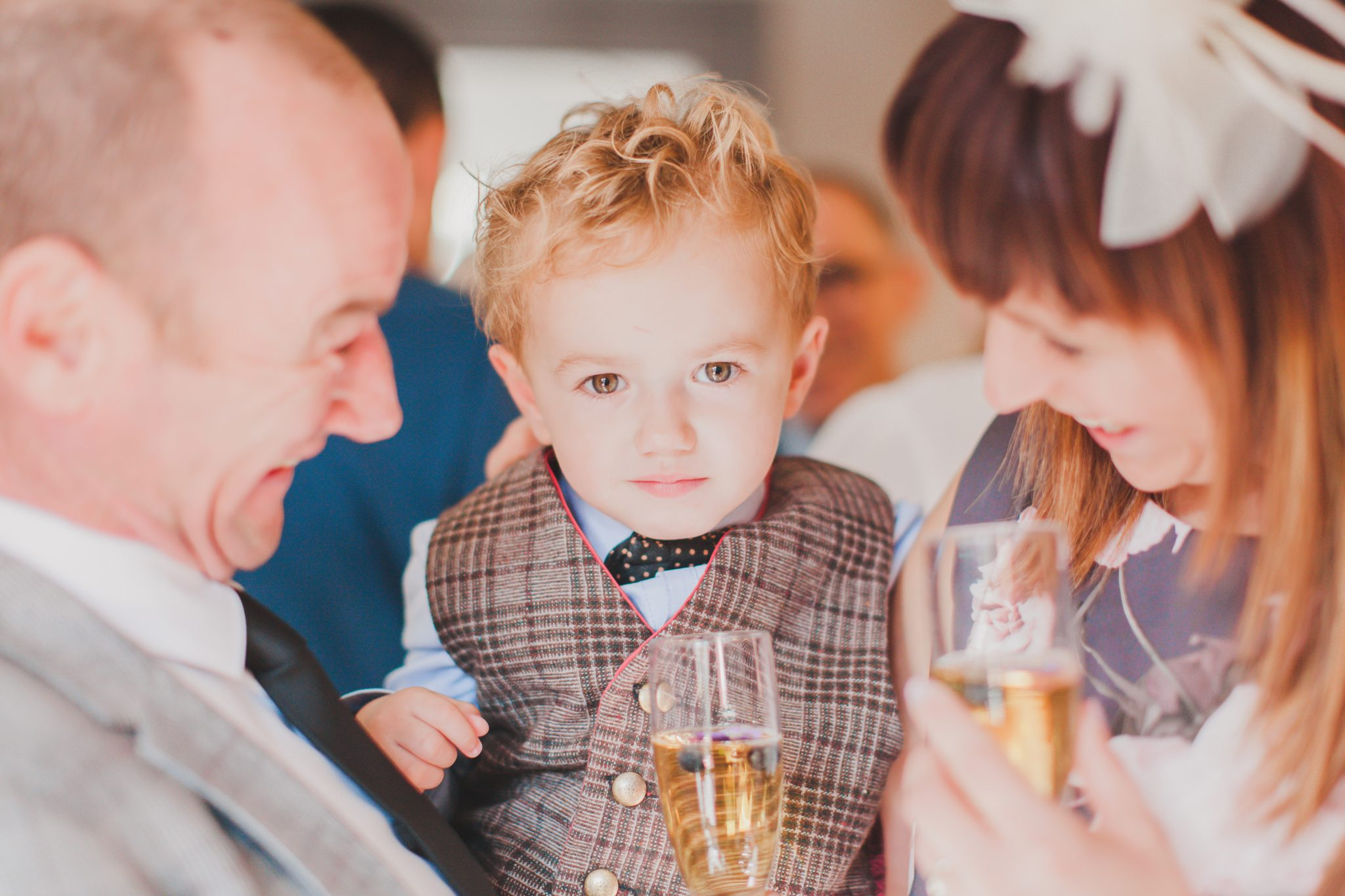 Little boy at wedding with bow tie
