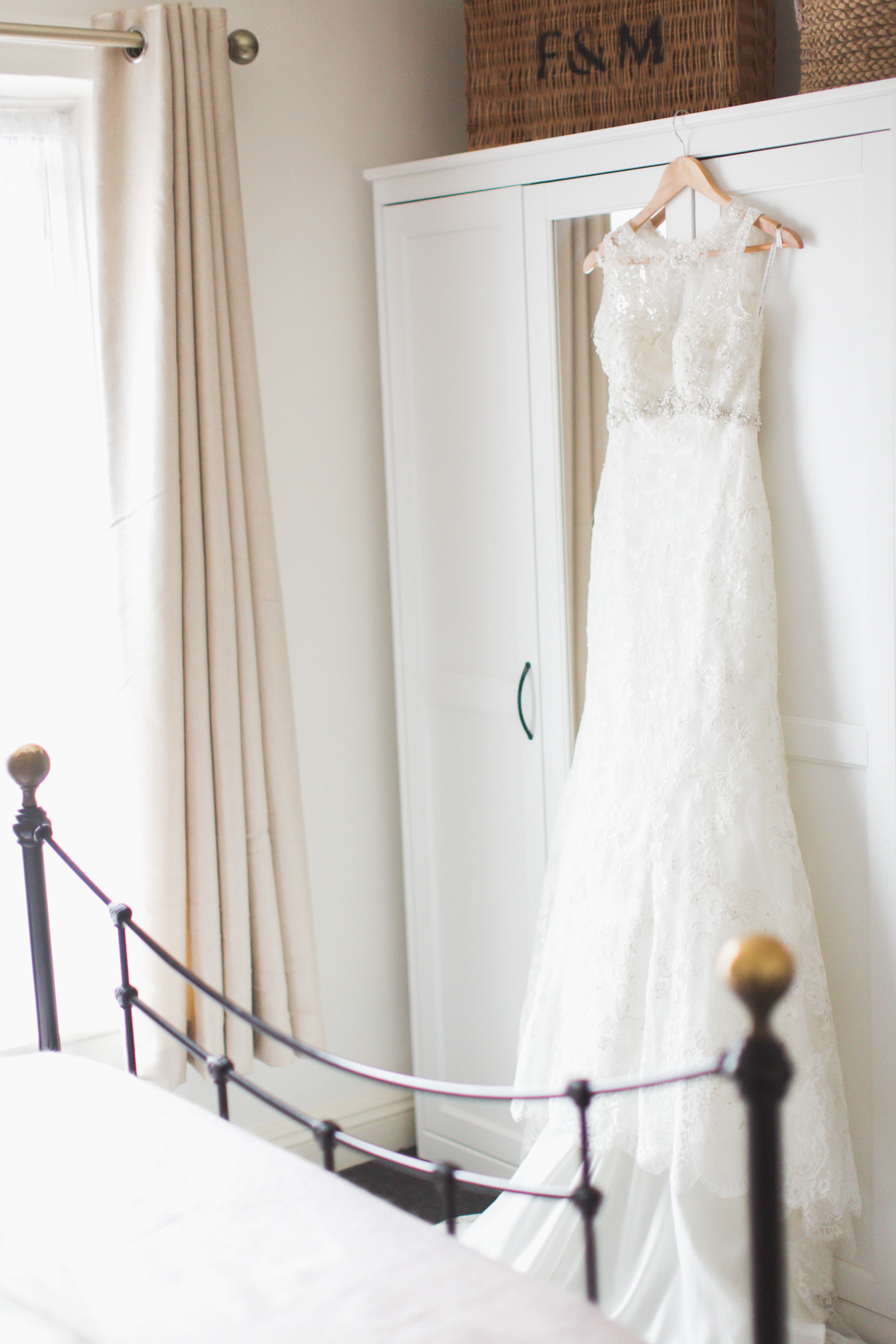 Brides dress hanging on the wardrobe