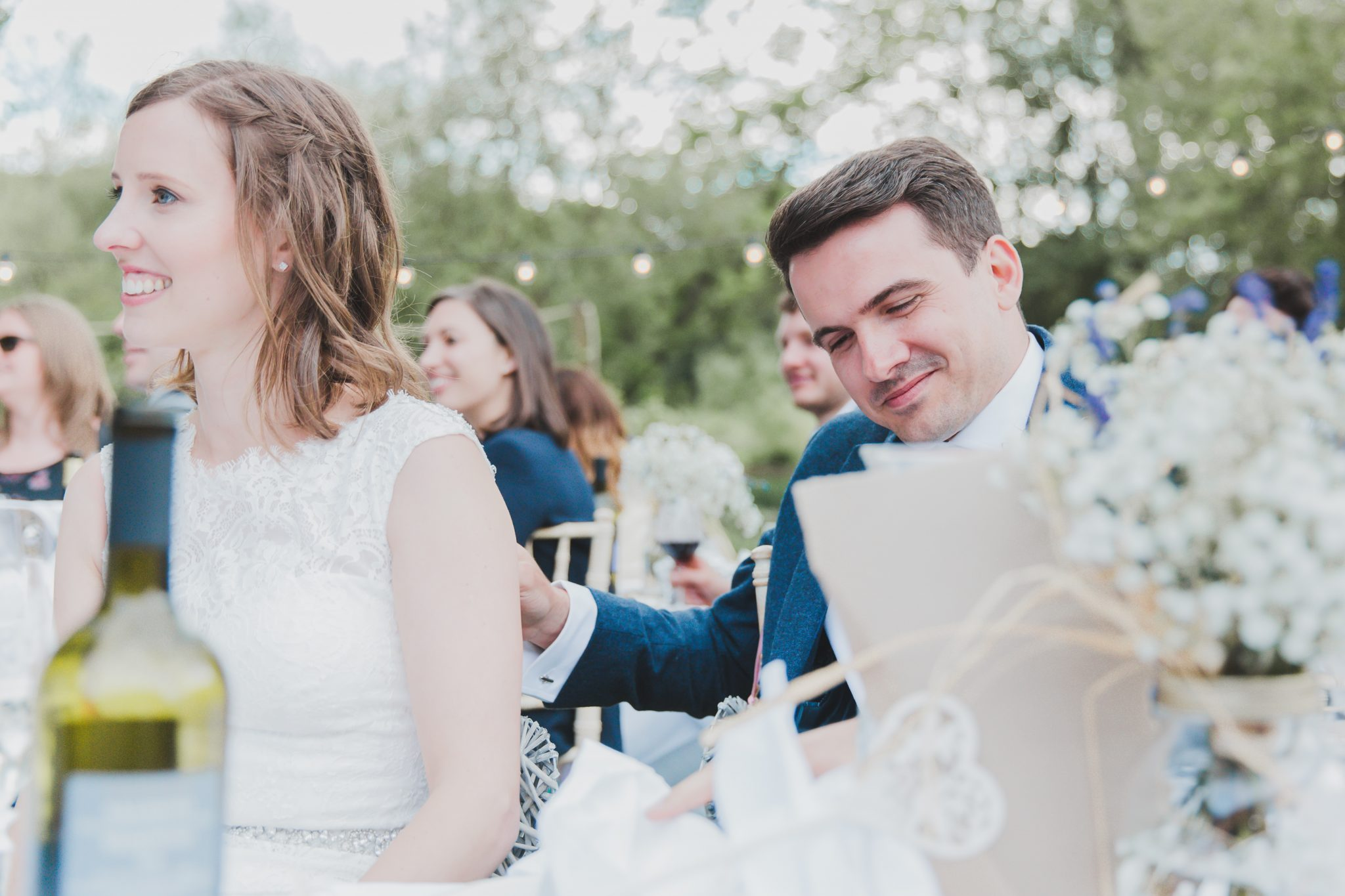 Groom smiling to himself during speeches